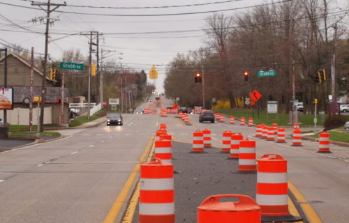 Orange And White Traffic Barrels Lined Along Grubb Road