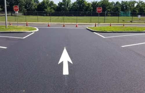 White Forward Facing Arrow Pavement Marking on Blacktop