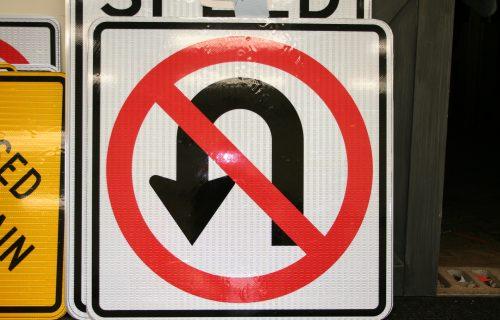 White, Black, And Red No U-Turn Maintenance Of Traffic Sign