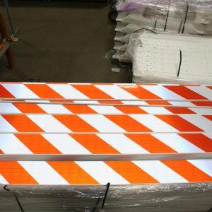 Pile Of Orange And White Reflective Panels