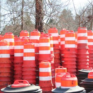 Reserve Of Orange And White Traffic Barrels